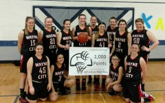 Bass Joins 1,000 Point Club